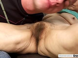 Saggy breasted granny fucks a junior guy