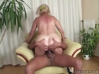 Busty mature woman and a dark-hued cock