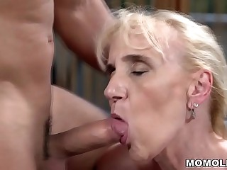 Muscular guy fucks a mature chick