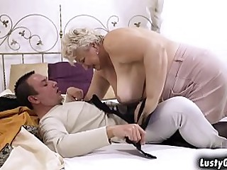 Busty granny Astrid welcomes grandson with a warm sex