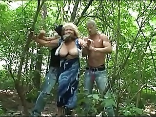 Busty grandma kidnapped and fucked in the woods