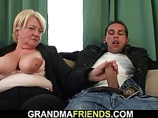 Busty granny takes two cocks at once