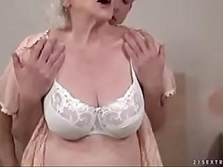 Buxomy grandma sucking cock