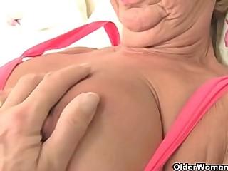 British gilf Elle does a slow striptease and frigs her needy fanny. Bonus video: English granny Samantha.