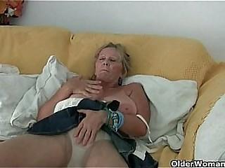 Granny with big tits masturbates in stockings