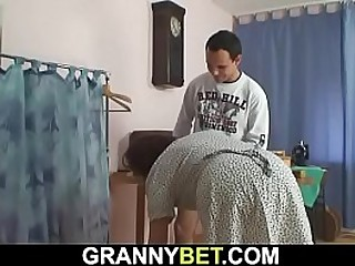Sewing granny enjoys sucking and riding his dick