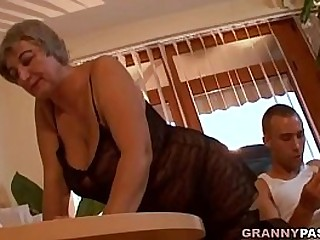 Big-titted Granny Seduces Young Guy With Her Big Boobs