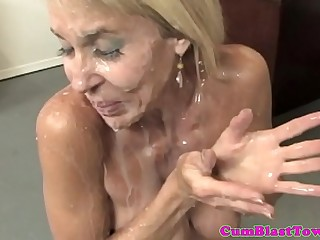 Busty granny cumblasted by happy young man