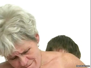 Hairy granny tastes youthful dick