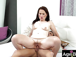 Young stud Dom's creamy load on granny Alice's face
