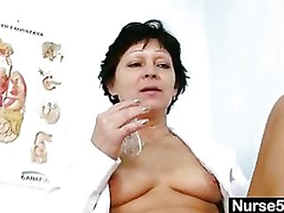 Cool Milf in nurse uniform stretching hairy pussy