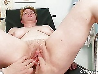 Gross mom gets a swab stick up her hairy pussy