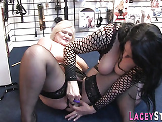Lezzie grandma in sex store eats out