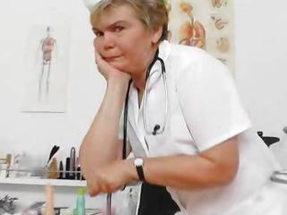 Cougar masturbation with a medicalinstrument in uniforms