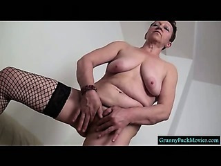 Dirty granny fingering her S/M old pussy