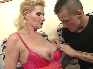 Breasty mother takes large penis of youthful son