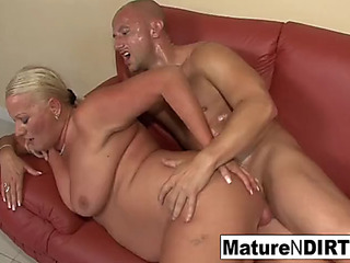 Breasty blond grandma takes it in the butt