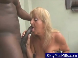 Dirty old granny blowing  a huge dark-hued dick