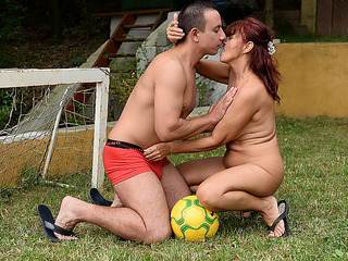 Aged redhead is having outdoor lovemaking with a younger boy