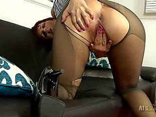 Ripped hose are glamorous on a masturbating older redhead