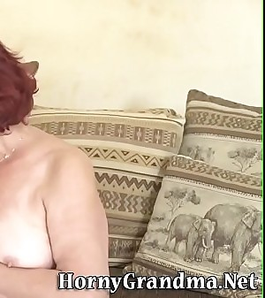 Round redheaded old woman sucks cock