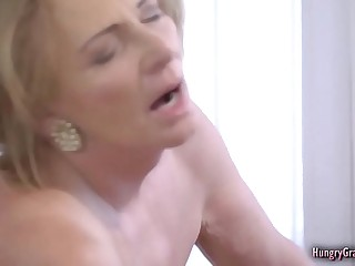 Horny light-haired grandma enjoying a firm cock