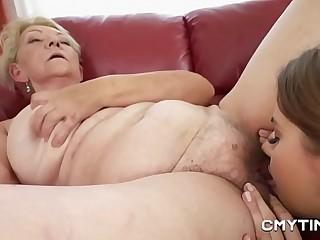 Teen cutie in lesbian pornography with a GILF