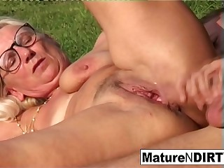 Blonde grandma gets some spunk on her glasses