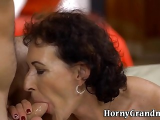 Pussy rubbed mature woman gobbles cock